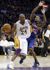 Los Angeles Lakers Bryant drives past New York Knicks Douglas during their NBA basketball game in Los Angeles