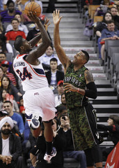 Hawks Williams puts up a shot over Raptors Johnson during their NBA basketball game in Toronto