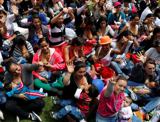 Mothers breastfeed their babies, as part of the celebration for World Breastfeeding Week, at Lovers Park in Bogota, Colombia