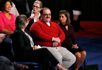 Ken Bone waits to ask a question about energy policy and jobs to Republican U.S. presidential nominee Donald Trump and Democratic nominee Clinton during their debate at Washington University in St. Louis