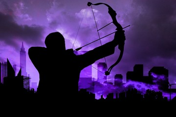 Shadow of archery player in front of purple sky background