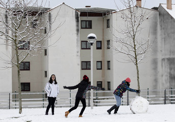 A group of girls play with snow after a snowstorm in Lalin, northern Spain