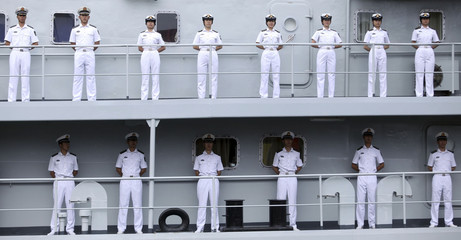 Chinese navy personnel stand at attention on Chinese military vessel Zheng He as it arrives in Guayaquil