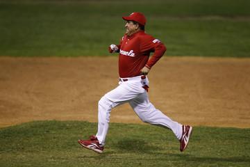 Venezuela's President Hugo Chavez runs between second and third base during a friendly softball game in Caracas