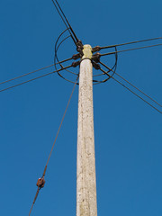Electricity distribution pole in a rural location in the UK, making power available to remote locations in the countryside.