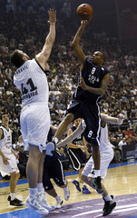 Kinsey of Anadolu Efe makes a shot against Pekovic of Partizan Belgrade during their Euroleague Group C basketball game in Belgrade