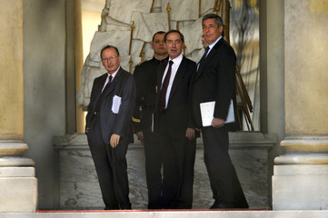 France's President Sarkozy's advisors Soubie, Gueant and Guaino stand at the entrance of the Elysee palace