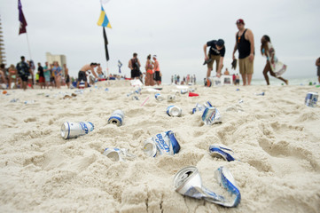 Empty beer cans litter the beach during spring break festivities in Panama City Beach Florida