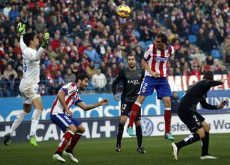 Atletico Madrid's Godin scores against Levante during their Spanish first division soccer match at Vicente Calderon stadium in Madrid