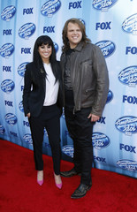 Jena Irene and Caleb Johnson arrive at the American Idol XIII 2014 Finale in Los Angeles