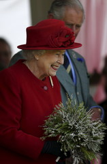 Britain's Queen Elizabeth receives a posy at the annual Braemar Highland Gathering in Braemar, Scotland