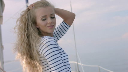 Young woman taking photo of beautiful sea lagoon on smartphone