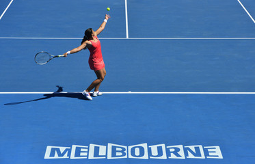 Marion Bartoli of France serves to Vesna Dolonc of Serbia during their women's singles match at the Australian Open tennis tournament in Melbourne
