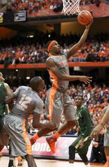 Syracuse Orange forward C.J. Fair takes a shot during the first half of their NCAA men's basketball game against South Florida Bulls in Syracuse, New York