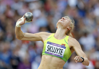 Lithuania's Austra Skujyte competes in women's heptathlon shot put event at London 2012 Olympic Games