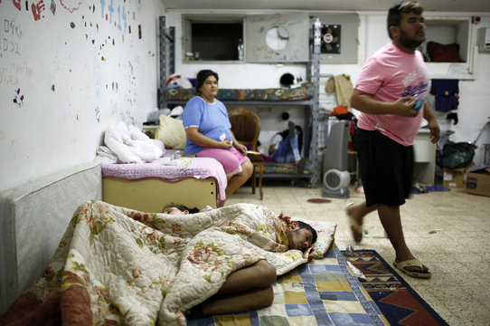 An Israeli couple sleeps in a bomb shelter in Ashkelon