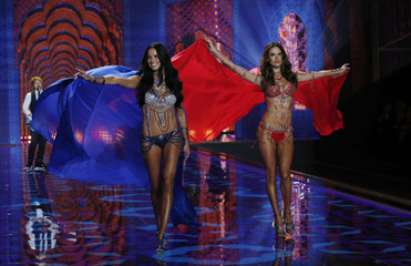 Models Lima and Ambrosio present creations at the 2014 Victoria's Secret Fashion Show in London