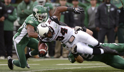 Redblacks Hayes is tackled by Roughriders Maze during first half pre-season CFL game in Regina