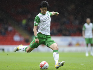 Celtic's Ki shoots against Aberdeen during their Scottish Premier League soccer match at Pittodrie Stadium in Aberdeen