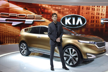 Kia Design Center America's Tom Kearns poses with the Kia Cross GT at the Chicago Auto Show