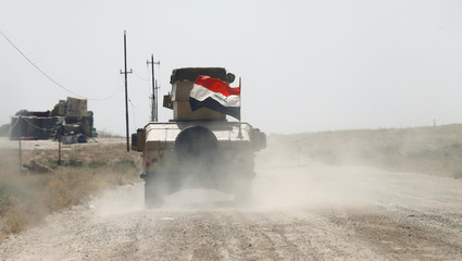 A military vehicle of the Iraqi army is seen in Falluja