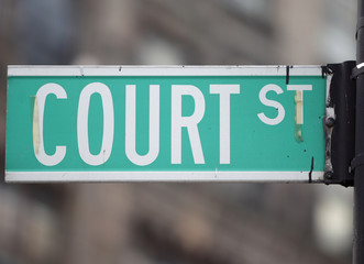 A street sign is seen outside the courthouses on Court Street in Brooklyn, New York