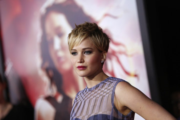 """Cast member Jennifer Lawrence poses at the premiere of """"The Hunger Games: Catching Fire"""" in Los Angeles"""