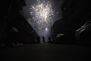 Man sets off fireworks as residents celebrate the start of the Chinese New Year in Shanghai