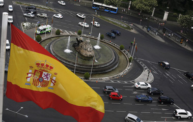 Spanish flag flutters above Cibeles fountain as they are seen from observatory deck of Madrid's city hall