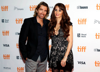 "Copley arrives with his wife, model Phoenix, on the red carpet for the film ""Free Fire"" during the 41st Toronto International Film Festival (TIFF) in Toronto"