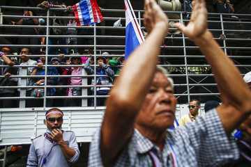 Anti-government protesters shout slogans during a rally at the Thai Police Headquarters in Bangkok
