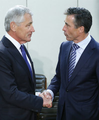 U.S. Defense Secretary Hagel shakes hands with NATO Secretary General Rasmussen during a NATO defence ministers meeting at the Alliance headquarters in Brussels