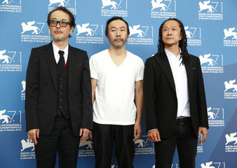 """Director Tsukamoto poses with cast members Franky and Nakamura during the photo call for the movie """"Nobi"""" (Fires on the plain) at the 71st Venice Film Festival"""