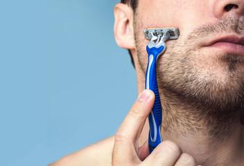 brutal bearded man with razor.