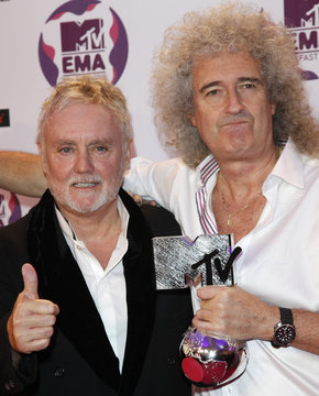 Queen guitarist Brian May and drummer Roger Taylor hold the Global Icon award at the MTV Europe Music Awards show in Belfast