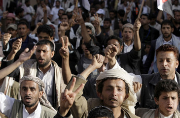 Protesters shout slogans as they demonstrate in Sanaa to demand for the ouster of Yemen's President Ali Abdullah Saleh
