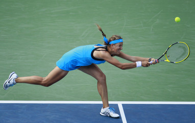 Victoria Azarenka of Belarus returns to Serena Williams of the U.S. during their match at the U.S. Open tennis tournament in New York