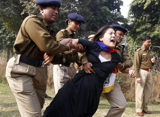 A Tibetan exile is detained by police during a protest over China's rule over Tibet, outside the Chinese embassy in New Delhi