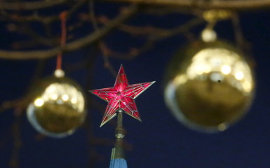 Christmas decorations are pictured on display in the Red Square, with a star seen on the top of a Kremlin tower in the background, in central Moscow