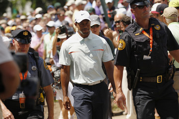 Tiger Woods of the U.S. walks from the first green to the second tee during the third round of the 2013 U.S. Open golf championship at the Merion Golf Club in Ardmore