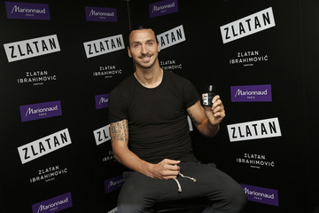 Paris Saint Germain's Zlatan Ibrahimovic poses for photographers as he launches his perfume at a store in Paris