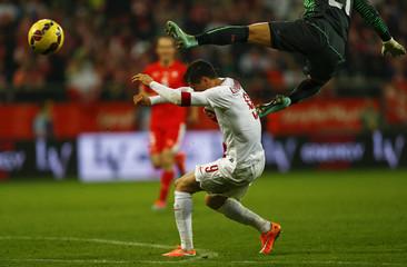 Lewandowski of Poland collides with Switzerland's goalkeeper Buerki during their international friendly soccer match at Wroclaw Stadium in Wroclaw