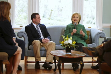 Clinton speaks with Ballard, facilities director for the SC STRONG, and other residents on a tour of the home for ex-offenders and substance abusers on grounds of the former Charleston Navy Yard in North Charleston, South Carolina