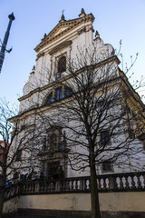 """A street in the """"Lesser town"""" district. Church of Our Lady Victorious .  Infant Jesus of Prague .  Area of the Old City. Prague, Czech Republic."""