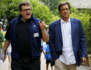 Hoffman, co-founder of LinkedIn, talks to Gordon, former Chief Creative Officer of video game publisher and developer Electronic Arts, during the first day of the annual Allen and Co. media conference in Sun Valley