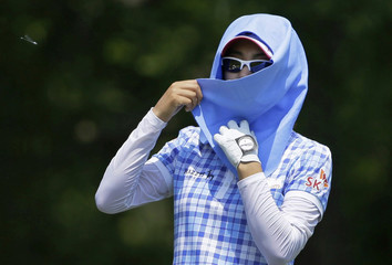 Choi of South Korea wraps her head with a towel during the U.S. Women's Open golf tournament at Blackwolf Run in Kohler