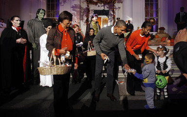 U.S. President Barack Obama and first lady MIchelle Obama partipate in the Halloween Trick or Treat in Washingotn