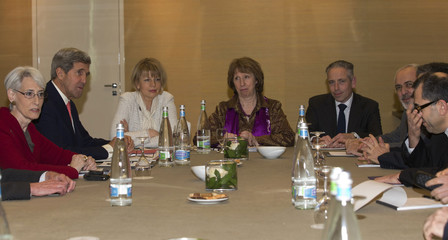U.S. Secretary of State John Kerry meets with European Union foreign policy chief Catherine Ashton and  Iranian Foreign Minister Mohammad Javad Zarif at the Iran nuclear talks in Geneva