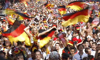 Soccer fans react during screening of 2010 World Cup quarter-final match in Berlin