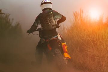 Poster Motorise man riding sport enduro motorcycle on dirt track